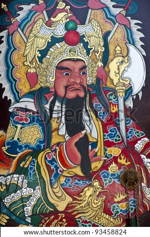 Close up Traditional type of temple gate in China Town Thailand. God of China on the door