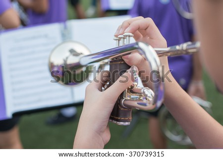 close up trumpet Fragment of pipe and finger - stock photo