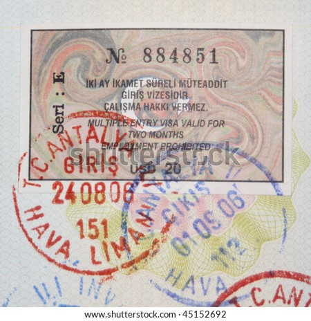 Close-up turkish 2006 year visa and customs stamps - stock photo