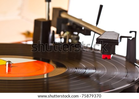 close up turntable while reading arm is lift up - stock photo