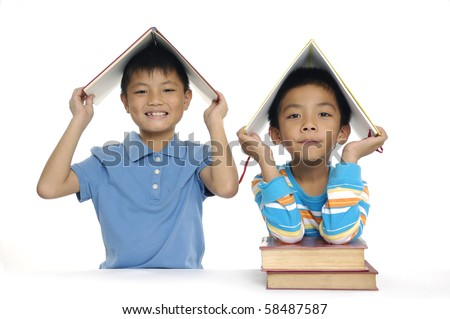 Close up two children with books - stock photo