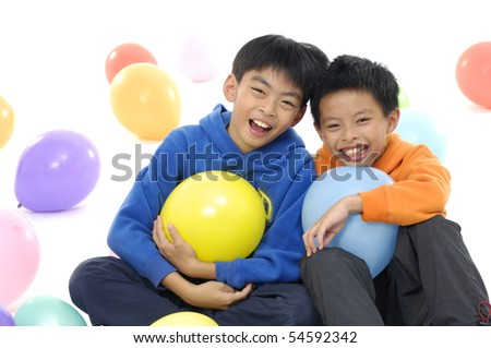 Close up two children with colorful balloons