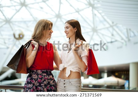 Close up, Two girlfriends with shopping bags - stock photo