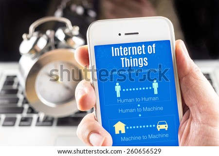 Close up Two hand holding smart phone with Internet of things (IoT) word and icons, Connectivity concept - stock photo
