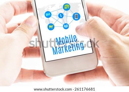 Close up Two hand holding smart phone with Mobile Marketing word and icons, Digital concept - stock photo