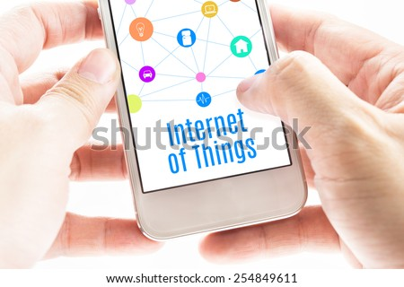 Close up Two hand holding smartphone with Internet of things word and icons, Digital Marketing concept - stock photo