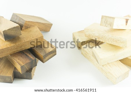 Close up two piles of black wooden and white wooden blocks on white backgroud. Think differenct concept for growth success process. - stock photo
