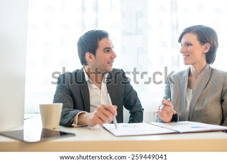 Close up Two Relaxed Business People Talking About Business Matters Inside the Office. - stock photo