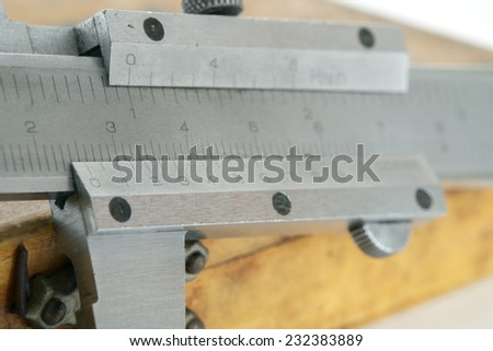 Close up used and dirty caliper, device used to measure on the table. - stock photo