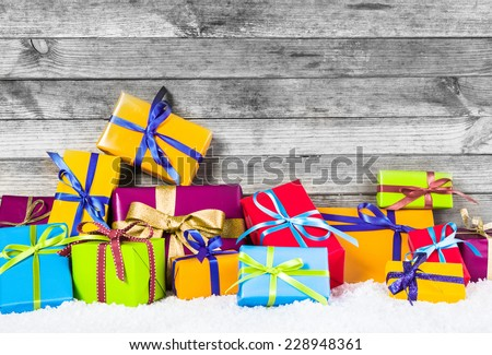 Close up Various Christmas Presents in Different Colors for Winter Holiday Season. Captured with Vintage Wood Background. - stock photo