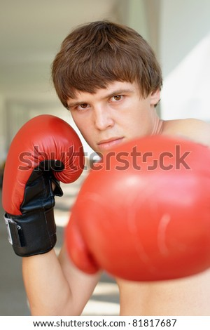 Close-up vertical photo of a boxer with red gloves - stock photo