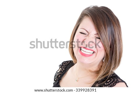 Close up Very Happy Woman Showing a Toothy Smile with Eyes Closed Against White Background with Copy Space on the Left. - stock photo