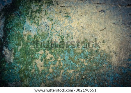 Close-up view a weathered, rough and dirty concrete wall with stain of lichen and mold. Pattern of rustic blue grunge material from old wall seamless texture in an ancient town of Vietnam. - stock photo
