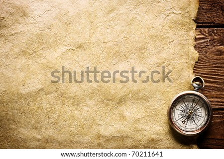 close up view Compass paper and wooden board - stock photo