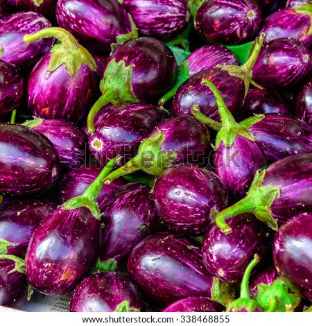 Close-up view group of fresh organic raw ripe Eggplant (or Brinjal) on display at Vegetable Stall of Local Market at Little India, Sinagpore. Colourful vegetable background and healthy concept - stock photo