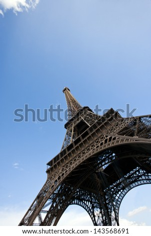 Close-Up view looking up at the Eiffel Tower in Paris, France - stock photo