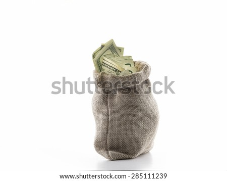close up view of a bag full of cash money dollars bills in amount - stock photo