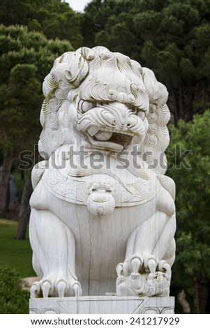 Close up view of a beautiful lion statue on a park. - stock photo