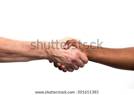 Close up view of a black / african woman and a white / caucasian man shaking hands - stock photo