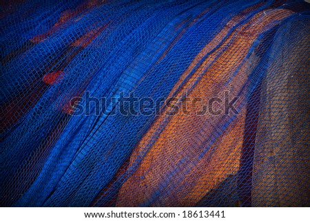 Close up view of a blue fishing net. Abstract background - stock photo