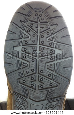 Close Up View of a Boot Sole on a White Background. - stock photo