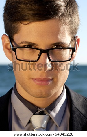 Close up view of a business man with glasses.
