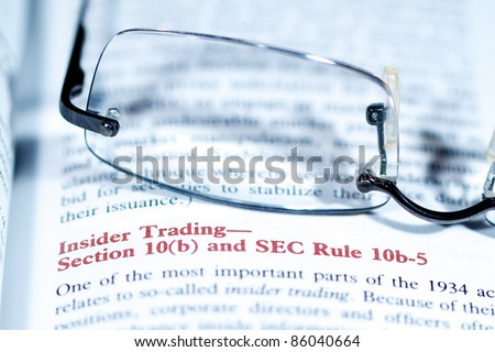 Close up view of a business word definition in a dictionary - stock photo