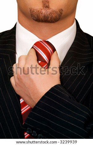 Close up view of a businessman's hand adjusting his necktie