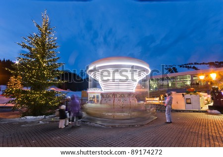 Close up view of a carousel spinning in Courchevel city during winter time, France - stock photo