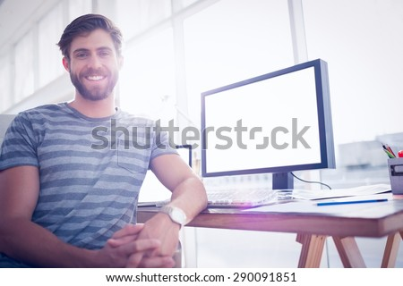 Close up view of a casual businessman smiling at the camera - stock photo