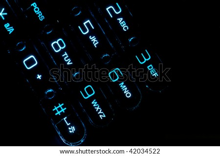 Close up view of a cell phone keypad backlit. - stock photo