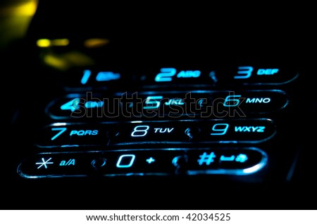 Close up view of a cell phone keypad ringing. Use of selective focus. - stock photo