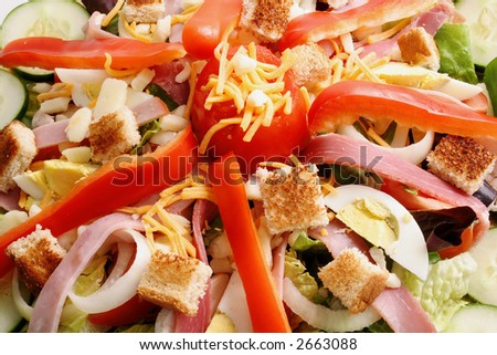Close up view of a Chef's Salad artfully arranged on a gold-tone platter. - stock photo