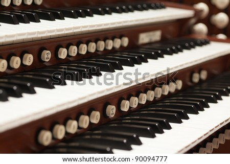 Close up view of a church pipe organ. - stock photo