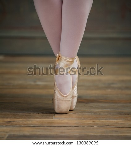 Close up view of a elegant ballerina standing on toes - stock photo