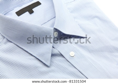 Close up view of a generic blue business shirt with a line pattern - stock photo