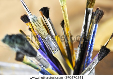 Close-up view of a group of dirty paint brushes