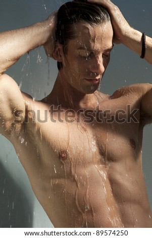 Close up view of a man having a shower.
