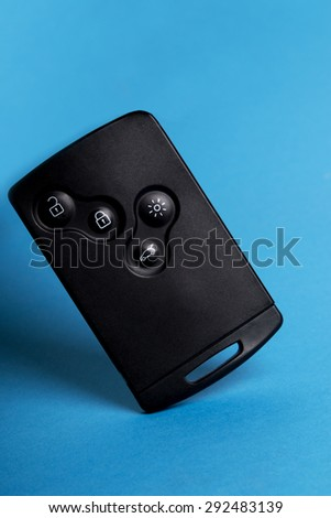 Close up view of a modern card car key isolated on a blue background. - stock photo