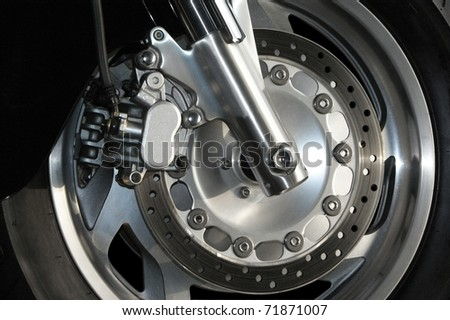 Close up view of a modern motorcycle wheel. - stock photo