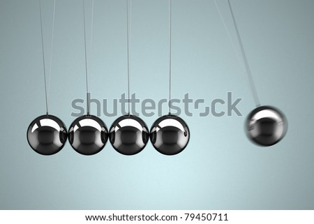 Close-up view of a Newton's Cradle with motion blur - stock photo