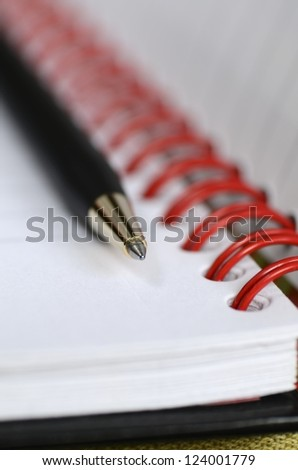 Close up view of a notebook or address book - stock photo