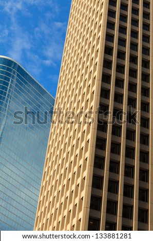 Close up view of a pair of downtown skyscrapers. - stock photo