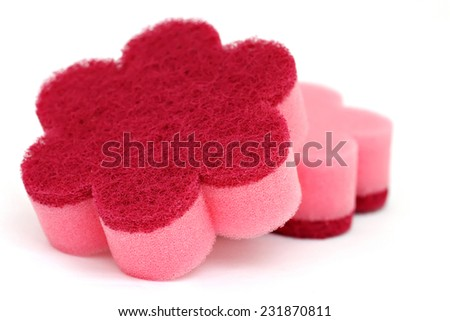 Close up view of a pink cleaning sponge isolated on a white back