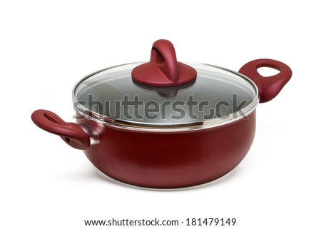 Close up view of a red cooking pan with transparent cover isolated on a white background.