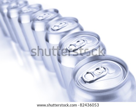 Close up view of a row of tin cans. Shallow depth of field. - stock photo