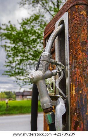 Close up view of a rusted gas pump and nozzle - stock photo