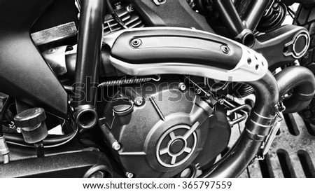 Close up view of a shiny motorcycle engine - stock photo