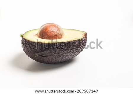Close up view of a sliced mature avocado fruit  ready as a salad ingredient, isolated on a white background