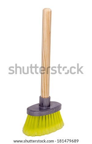 Close up view of a small dust brush with wood handle isolated on a white background. - stock photo